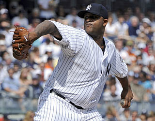 CC Sabathia dominates the Rays by allowing just three hits in seven innings while striking out 10.  (AP)