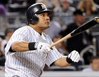 The Yankees' Melky Cabrera finishes the game with three hits while driving in two runs against the Rays.  (AP)