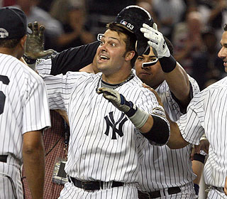 The Yankees are kind enough to remove Nick Swisher's helmet before his celebratory beating. (Getty Images)