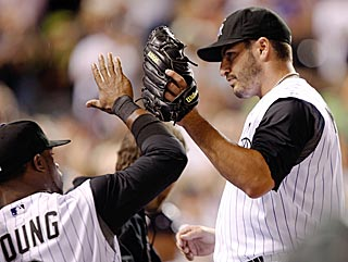 Eric Young offers congratulations to fellow game hero Jason Marquis after his 7 1/3 strong innings. (AP)