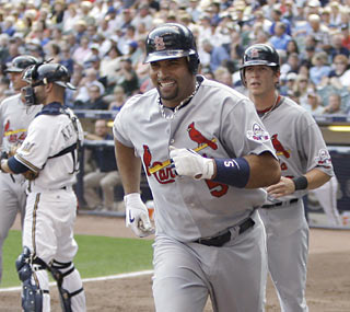 Albert Pujols, the MLB leader in homers, is all smiles following his second blast of the game.  (AP)