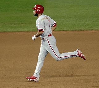 Pedro Feliz hits the second of the Phillies' back-to-back homers in the eighth, his 10th shot of the season.  (AP)