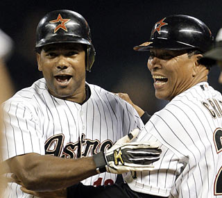 Miguel Tejada makes a lot of Astros happy with his game-winning, bases-loaded single in the ninth inning.  (AP)