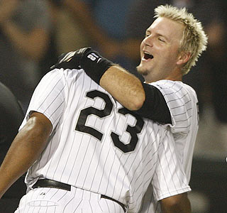 A.J. Pierzynski gets a hug from Jermaine Dye (23) following Pierzynski's game-winning RBI double. (AP)