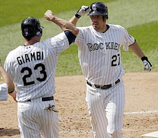 Jason Giambi and Garrett Atkins are at the center of Colorado's five-run third, driving in four.  (AP)