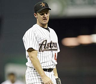 Roy Oswalt can't bear to watch, giving up six runs and 10 hits in two innings.  (AP)