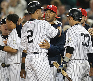After an ovation from the crowd, the Yankees go all out to greet and congratulate Derek Jeter. (Getty Images)