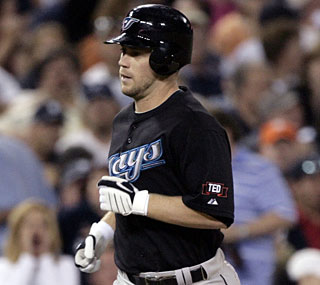 Aaron Hill breaks the tie in the ninth and breaks one of Roberto Alomar's club records.  (AP)