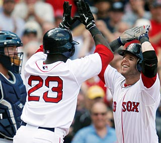 Dustin Pedroia (right) smacks a two-run shot in the eighth to provide the winning margin.  (AP)