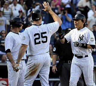 Hideki Matsui comes home following his three-run homer in the Yankees' big eighth inning.  (Getty Images)
