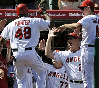 Torii Hunter is a popular man in the Angels dugout after his deciding home run in the seventh inning.  (AP)