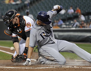 O's catcher Matt Wieters fails to tag out Jason Bartlett, who scores on a sacrifice fly in the first inning.  (AP)