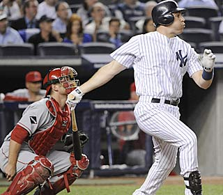 Mark Teixeira collects three hits, including a double and a triple, and keys the Yanks' rally.  (AP)