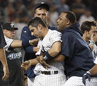 Teammates escort a heated Jorge Posada away after a bench-clearing brawl erupts in the eighth inning.  (AP)