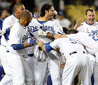 Andre Ethier receives yet another pounding from his teammates after his sixth walk-off hit.  (US Presswire)