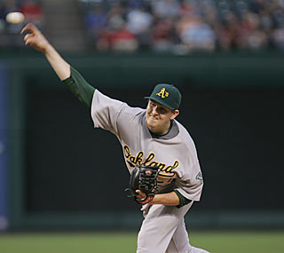 Trevor Cahill throws seven shutout innings as the A's put a major dent in the Rangers' playoff hopes.  (AP)