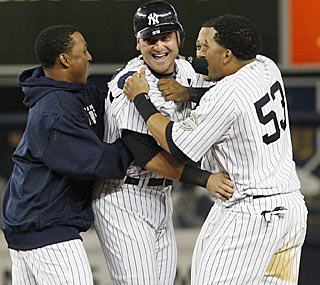 More Yanks rush the field just one day after the brawl, but it's only to greet game hero Francisco Cervelli.  (AP)