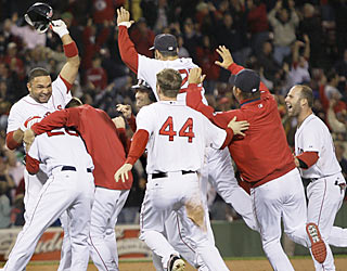 Alex Gonzalez (left) starts a wild celebration thanks to his game-winning bloop single with two outs in the ninth.  (AP)