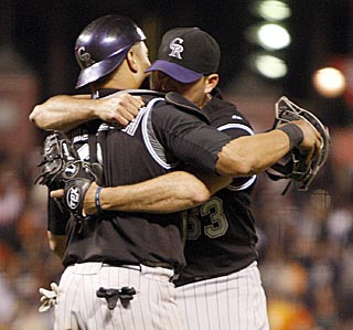 The Rockies can finally celebrate after Rafael Betancourt (right) works out of a ninth-inning jam.  (AP)