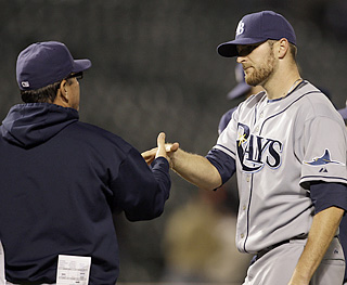 Joe Maddon congratulates Wade Davis, who fires a four-hit shutout for his first major league win.  (AP)