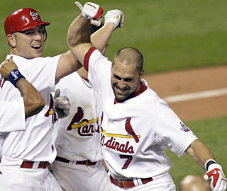 Matt Holliday high fives Mark DeRosa after the slugger goes deep for a walk-off homer in the ninth. (AP)