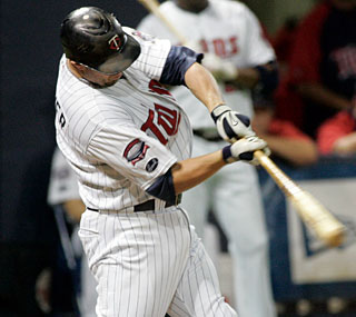 Michael Cuddyer's two-run shot is more than enough for the Twins to close the gap on the Tigers.  (AP)