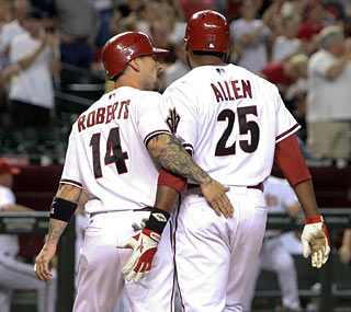 Ryan Roberts and Brandon Allen help the Diamondbacks top the wild-card leading Rockies.  (AP)