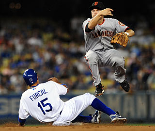 Freddy Sanchez turns a double play in the first inning of the Giants' win over the Dodgers. (AP)