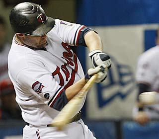 Michael Cuddyer's 28th homer of the year highlights the Twins' five-run eighth inning.  (AP)