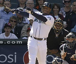 Ken Griffey Jr. watches his 627th career homer leave Safeco Field during his four-RBI game.  (AP)