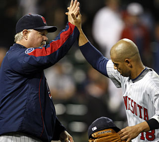 Ron Gardenhire and Orlando Cabrera celebrate another victory as the Twins make a run for the pennant.  (AP)