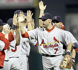 Mark DeRosa (four RBI) is a big reason why the Cardinals leave the field giving high fives.  (AP)