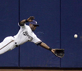 Milwaukee's Mike Cameron fails to come up with this sixth-inning drive -- a double for Derrek Lee.  (AP)