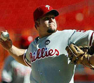 Joe Blanton strikes out nine over seven scoreless innings for the victory. (AP)