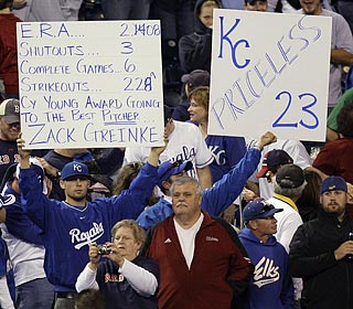 Several Kansas City fans display their appreciation for ace and AL Cy Young candidate Zack Greinke.  (AP)