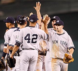 The Yankees take their clinching in stride, even after defeating the Angels in a thriller.  (Getty Images)