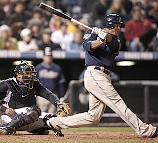 Will Venable rips a three-run triple in the fifth inning to increase San Diego's lead to 5-0.  (AP)