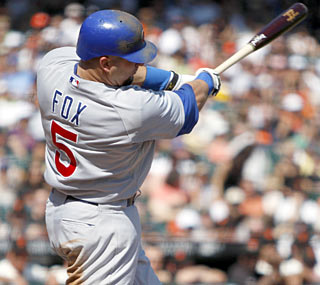 Jake Fox knocks a two-run single to help the Cubs deal another blow to the Giants' playoff hopes.   (AP)