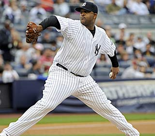 CC Sabathia allows 1 hit in seven innings to best Dice-K and lower the Yanks' magic number to one.  (AP)