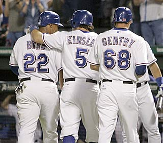Marlon Byrd is greeted by teammates after his sixth career grand slam, one of two homers he hits.  (AP)