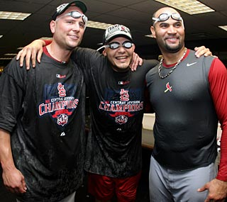 Matt Holliday (left), Yadier Molina and Albert Pujols will lead the Central champs in October.  (Getty Images)