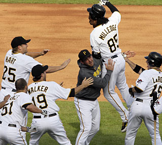 Lastings Milledge and the Pirates celebrate a miraculous comeback from a four-run hole in the ninth.  (AP)
