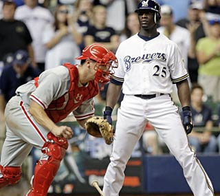Mike Cameron looks at a called third strike and the Phillies inch closer to a playoff spot.  (AP)