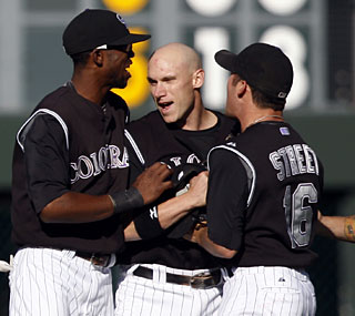 Clint Barmes (middle) is congratulated by teammates after his game-saving diving catch.  (AP)