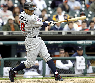 This single by Orlando Cabrera in the 10th lifts the Twins in Game 1 of a day-night doubleheader. (AP)