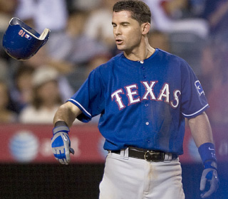 Well, so much for that. Despite a valiant run, Michael Young and Texas aren't going to the playoffs. (AP)