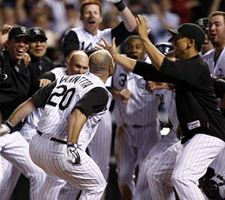 Chris Iannetta, who has struggled this season, is the hero on this night with his walk-off shot in the 11th.  (AP)