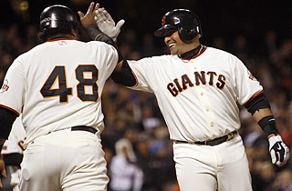 Bengie Molina hits his 19th and 20th homers of the season, earning props from Pablo Sandoval (48).  (AP)