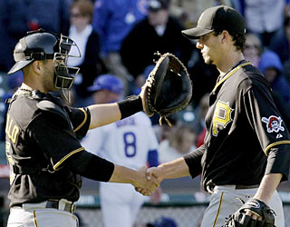 Pirates catcher Jason Jaramillo congratulates Charlie Morton for his four-hit complete game.  (AP)