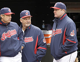 Manager Eric Wedge (right) watches his Indians prevail in the first game following the news of his termination.  (AP)